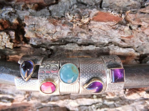 Terry Guile rings set with amethyst iolite turquoise antique almandine garnet